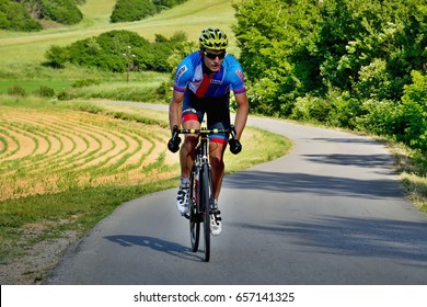 BANSKA BYSTRICA, SLOVAKIA - JUNE 08, 2017: Cyclists rising to the top of the hill on second stage of road cycling championship - Tour of Slovakia