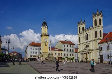 Banska Bystrica, Slovakia - May 10, 2013: Town square  with Clock Tower and St Franciska church (Kostol)
