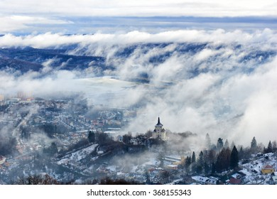 Banska Stiavnica on a foggy winter morning.