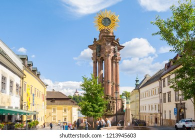 BANSKA STIAVNICA, SLOVAKIA - AUGUST 2018: tourists sightseeing in historical city center on August 2018 in Banska Stiavnica