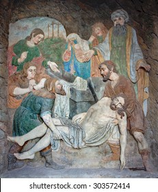 BANSKA STIAVNICA, SLOVAKIA - FEBRUARY 19, 2015: The detail stone relief of Burial of Jesus as the part of baroque Calvary from years 1744 - 1751.