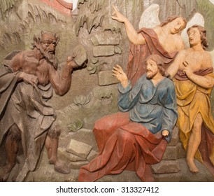 BANSKA STIAVNICA, SLOVAKIA - FEBRUARY 5, 2015: The carved relief of Temptation of Jesus on the desert as the part of baroque Calvary from years 1744 - 1751 by Dionyz Stanetti.