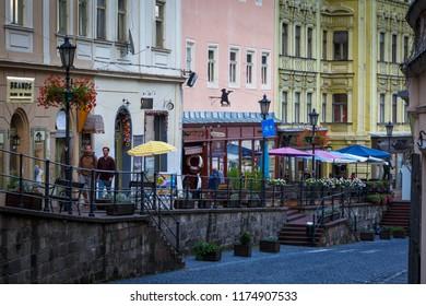Banska Stiavnica, Slovakia - July 22, 2018: Shops in the main street of the old town in Banska Stiavnica in central Slovakia.