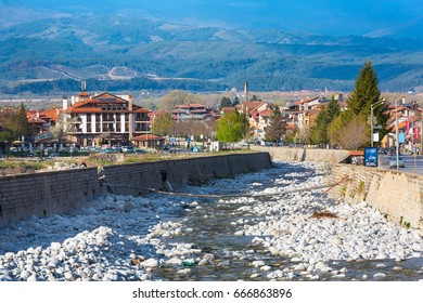 Bansko, Bulgaria - April 14, 201: Spring view with river Glazne, mountains landscape and houses in all season resort Bansko