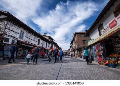 Bansko, Bulgaria - April 28, 2019. People walk inside Bansko old town.