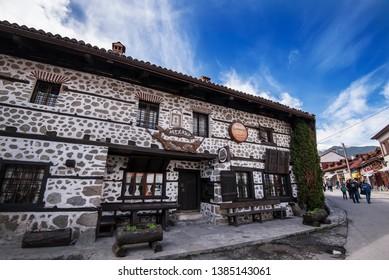 "Bansko, Bulgaria - April 28, 2019. A traditional restaurant or ""Mehana"" at the town of Bansko."