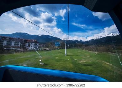 Bansko, Bulgaria - April 29, 2019. View from inside a Gondola Lift enroute from the town of Bansko to Bansko Ski Resort.