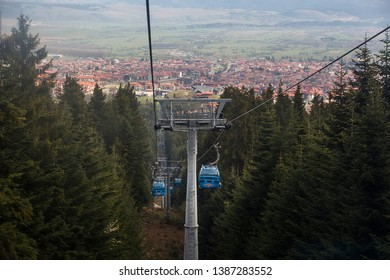 Bansko, Bulgaria - April 29, 2019. Cable Cars enroute from Bansko town to Bansko Ski Resort, with the town of Bansko at the background.