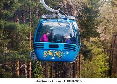 Bansko, Bulgaria - April 29, 2019. People inside a cable car enroute from Bansko town to Bansko Ski Resort.