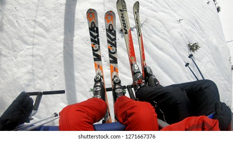 Bansko, Bulgaria - circa Feb, 2018: Close-up of skiers and snowboarders on a cable ski lift in the morning in Bansko. Recreation active sport seasonal concept