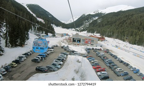Bansko, Bulgaria - circa Mar, 2018: POV from gondola cabin ski lift at arrival station up at mountain summit. It transport skiers from Bansko to Banderitsa ski slope station on Pirin mountain