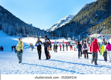 Bansko, Bulgaria - December, 12, 2015: Ski resort Bansko, Bulgaria, pistes and mountain with pine trees, ski slope, people walking and skiing