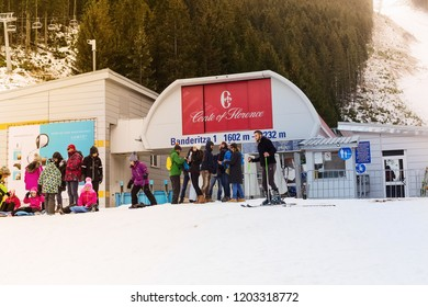 Bansko, Bulgaria - December 16, 2017: Bansko ski lift station, Banderitza chair lift and skiers