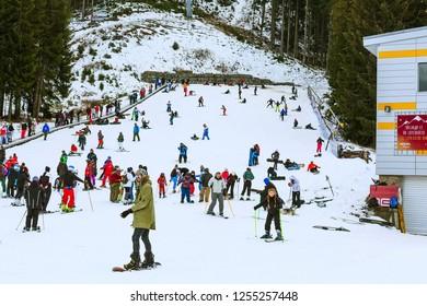 Bansko, Bulgaria - December 16, 2017: Winter resort Bansko, ski slope view with skiers and snowboarders