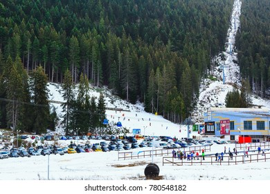 Bansko, Bulgaria - December 16, 2017: Winter ski resort Bansko, ski slope, people skiing and mountains view