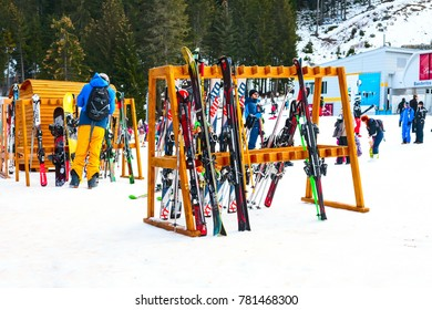 Bansko, Bulgaria - December 16, 2017: Winter ski resort Bansko, ski storage, skiers and mountains view