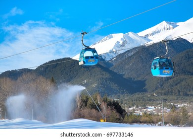 Bansko, Bulgaria - February 19, 2015: Bansko cable car cabin in Bansko, Bulgaria and snow mountain peaks at the background