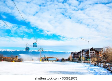 Bansko, Bulgaria - February 19, 2015: Winter ski resort Bansko, ski slope, people skiing and mountains view