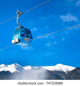 Bansko, Bulgaria - February 19, 2015: Cable car cabin and snow peaks of the mountains