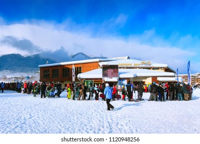 Bansko, Bulgaria - February 28, 2018: Bansko ski station, cable car lift and people queue