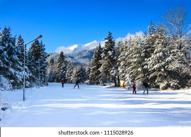 Bansko, Bulgaria - January 22, 2018: Winter ski resort Bansko with ski slope, skiers and mountains view