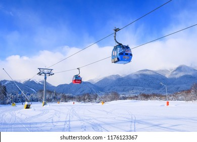Bansko, Bulgaria - January 22, 2018: Winter ski resort with ski slope, gondola lift cabins, and mountains view