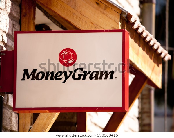 "BANSKO, BULGARIA - MARCH 01, 2017: The logo of the brand ""Moneygram"" over the wooden background"