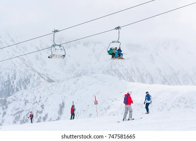 Bansko, Bulgaria - March 4, 2016: Ski resort, skiers on the slope at the high lift station, Bansko, Bulgaria