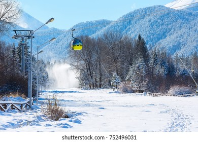 Bansko, Bulgaria ski resort panorama with cable car ski lift cabin and, slope and snow mountains