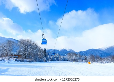 Bansko, Bulgaria winter ski resort with ski slope, lift cabins, and mountains view