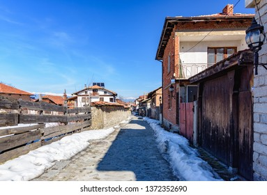Bansko, Bulgaria-February 12 .2019. Old streets of Bansko in Bulgaria.Nice Sunny weather. Holidays people relax in the ski resort in the winter