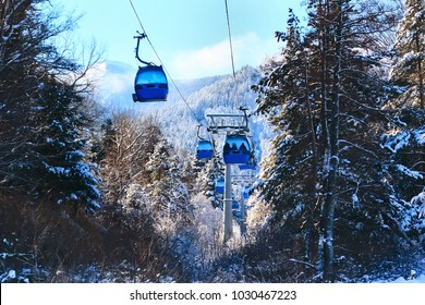 Bansko ski resort panorama with ski lift cabin, snow mountains, Bulgaria