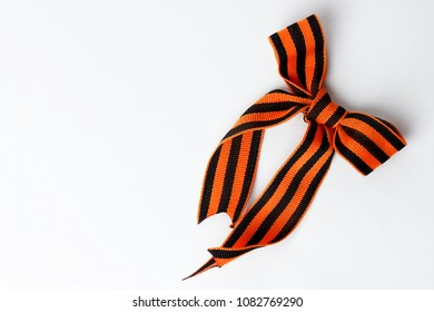 Bant of black and orange ribbons of St. George isolated on white background