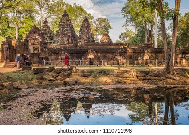 BANTEAY SREI, CAMBODIA– ANUARY 8, 2018: Considered by many to be the jewel in the crown of Angkorian art, Banteay Srei is cut from stone of a pinkish hue and includes some of the finest stone carving