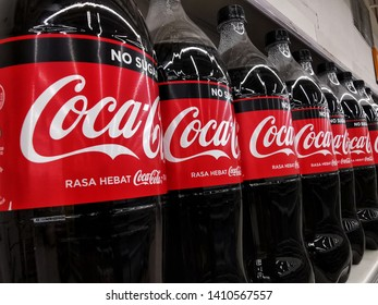 Banting, Malaysia - 19th May 2019: No Sugar Coca Cola Bottles neatly arranged on a shelf shot with selective focus inside a Supermarket in Banting, Malaysia