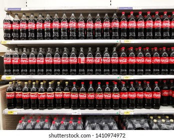 Banting, Malaysia - 19th May 2019: Coca Cola Bottles neatly arranged on a shelf shot with selective focus inside a Supermarket in Banting, Malaysia