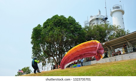 BANTING, Malaysia - FEBRUARY 26, 2019 :  Paraglider taking off from Jugra Hill in Banting, Selangor. Jugra is one of the best location for paragliding in Malaysia.