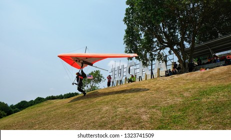 BANTING, Malaysia - FEBRUARY 26, 2019 : Hang gliding at Jugra Hill in Banting, Selangor. Jugra is one of the best location for extreme sports in Malaysia.