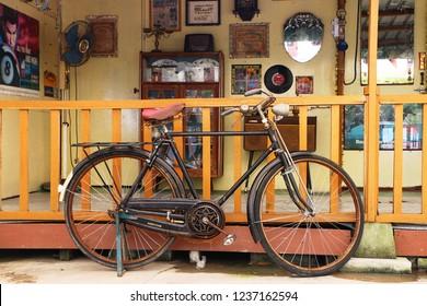 Banting, Selangor, Malaysia - November 18, 2018 : Old Hercules bicycle model park in front of an old house in Banting, Selangor.