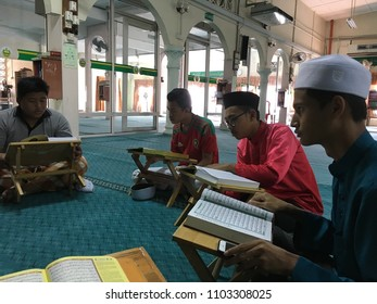 BANTING,MALAYSIA - 19 May 2018:- Muslim teenagers gathered for Tadarus Al-Quran/Reading Holy Quran in a group during Holy Month of Ramadan.