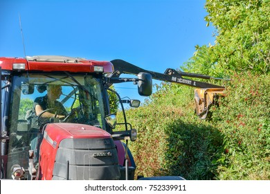 Bantry,Ireland - July 17, 2017: Tractor cutting hedgerow
