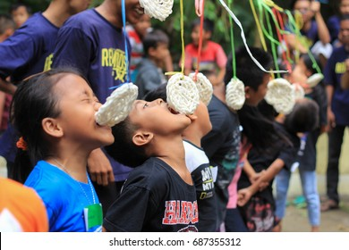 Bantul, Yogyakarta, Indonesia 14th of August 2016. Eat crackers in Celebration Competition of Indonesian Independence Day