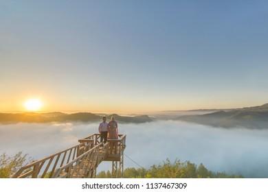 Bantul, Yogyakarta, Indonesia 5th of May 2018. Two People enjoying Misty morning at Panguk Hill, Dlingo, Bantul, Yogyakarta, Indonesia
