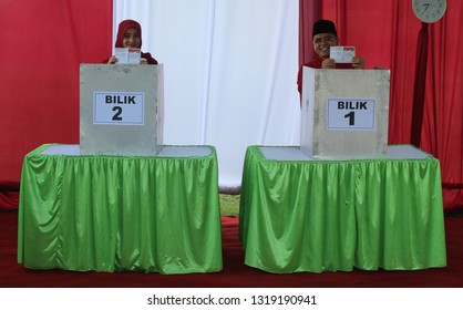 Banyuwangi, east java / Indonesia, December 2015 :  The regent of Banyuwangi Abdullah azwar anas and his wife were giving voting rights at the general election, at the polling station (TPS)