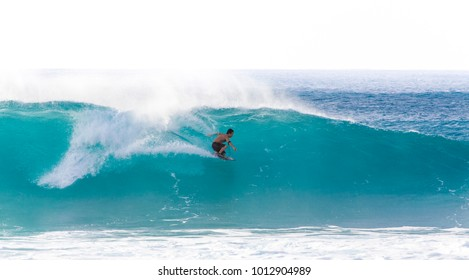 Banzai Pipeline, Oahu/Hawaii, February 27, 2017: A surfer riding barrels of the Banzai Pipeline, a very popular pro-surf spot at the Northshore region of Oâ??ahu.