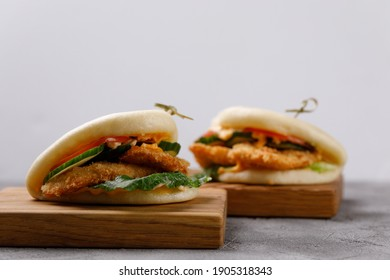 Bao buns. Hawaiian dish, on a wooden table. Pan-Asian cuisine concept.