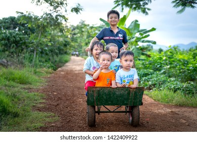 Bao Loc, Lam Dong province, Vietnam - Jun 1, 2019: Rural children play on strollers in Bao Loc, Lam Dong province, Vietnam