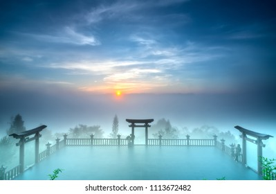 Bao Loc, Vietnam - May 15th, 2018: The magical dawn on the pagoda, surrounded by dew and magical light from the beautiful sun to meditate and relax the soul in Bao Loc, Vietnam