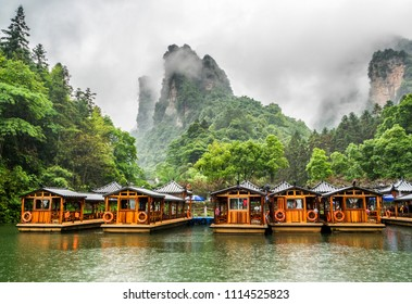 Baofeng Lake Boat Trip in a rainy day with clouds and mist at Wulingyuan, Zhangjiajie National Forest Park, Hunan Province, China, Asia