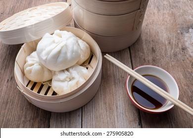 baozi chinese dumplings on bamboo steamer